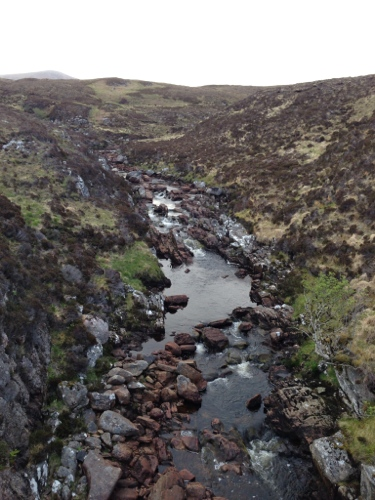 Bridge over rocky stream