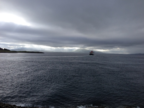 Cloudy skies off Oban, ferry outgoing