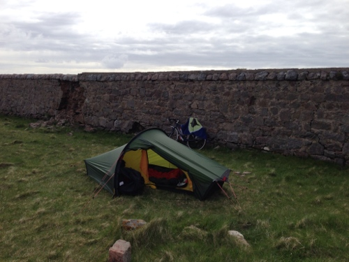 Tent set up in the lea of the wall