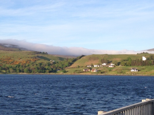 Uig pier - clouds rolling over hill again