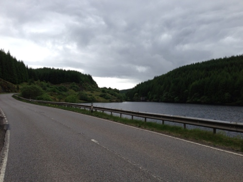 Road twists and turns through mountains and past lochs