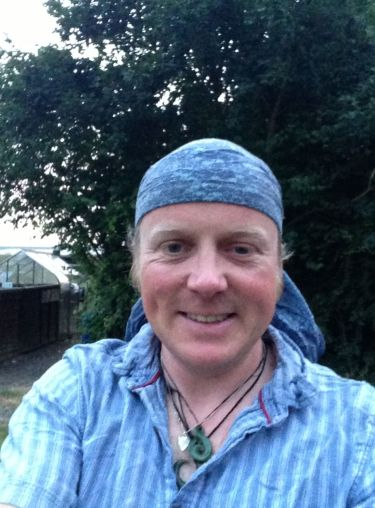 Me post a hot days ride, still look dishevelled, hair under control courtesy of a bandanna