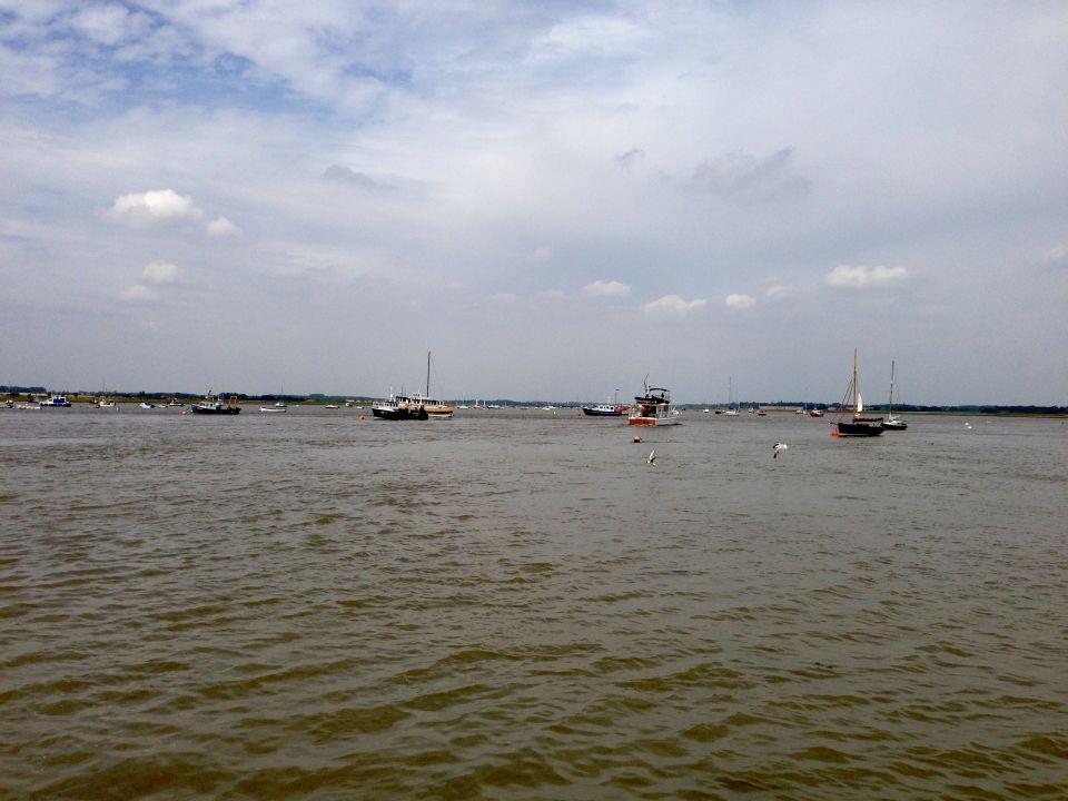 Crossing the River Deben lookin upstream, los of boats bobbing about