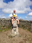 Whernside - Chris straddling the trig point
